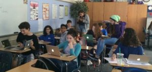 students using MacBook Airs in classroom