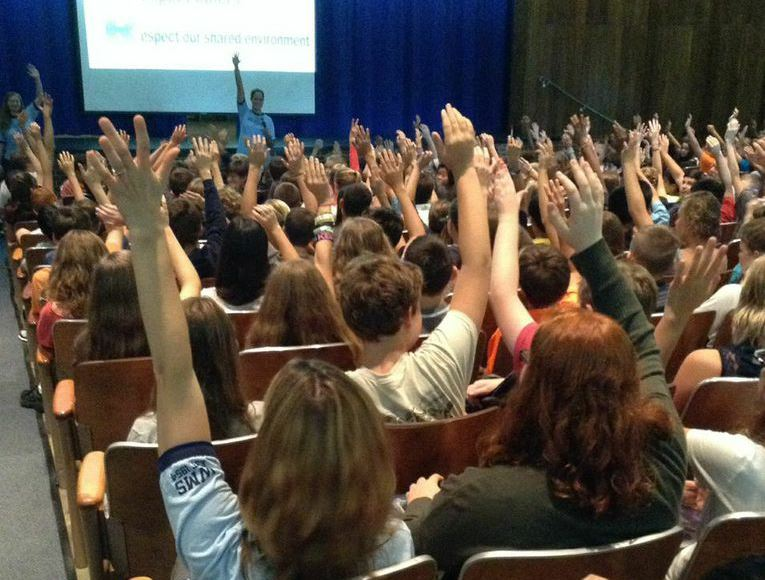 photo of students raising hands