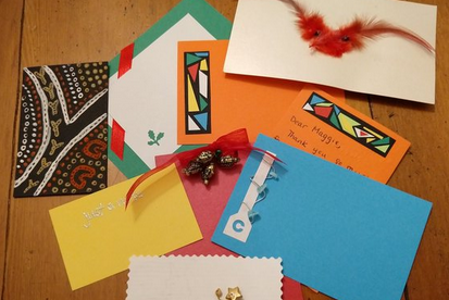 colorful cards made from paper, feathers, wire